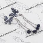Великолепные серьги украшенные бабочкой, цепями и камнями горного хрусталя.