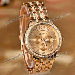 GENEVA великолепные женские часы украшенные круглым циферблатом с кристаллами, цифрами, указывающими время и браслетом из стали.(Цвет - розово-золотистый)